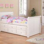 Lovable White Pop Up Trundle Bed Frame Idea With Simple Headboard And Corner Potter Plant And Storage And Woodne Flooring
