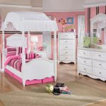 Lovely White Pink Princess Bedding Idea With Stripe Pattern And White Canopy And Brown Area Rug And White Vanity And Wooden Floor And White Dresser