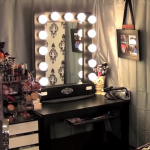 luxurious-and-modern-vanity-table-with-hollywood-style-and-lighted-mirror-on-the-black-dresser-and-cosmetics