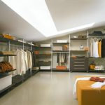luxurious and spacious dressing room design in loft with long skylight and yellow pouf and wall storage