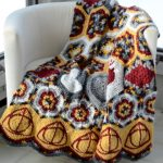 luxurious sheepskin harry potter throw blanket idea in white yellow red and black color combination on white sofa idea in the corner of a room