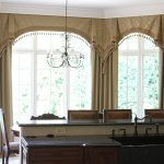 luxurious window treatment and curtain rods for bay windows in kitchen with brown elegant curtain and valance plus classic chandelier above
