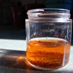 make your own fruit flies trap by using vinegar water and soap