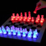 Modern LED Chess Set With Glowing Red And Blue Pieces On The Chessboard And In The Dark Place