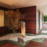 modern and minimalist courtayard idea with stone and cherry blossom and wooden siding and wooden floor