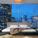 modern bedroom ideas with low profile platform bed frame combined with white bedding and awesome wood flooring plus cool pendant lamp and standing lamp
