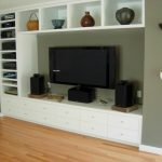 modern in wall entertainment center with drawers and display shelves for ceramic decorative objects plus media storage and adorable laminate floor