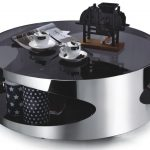 modern minimalist round coffee table made from stainless steel and glossy black acrylic surface
