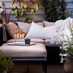 Narrow Balcony Ida With Luxurious Cream Sofa With Coffee Table And Climbing Tree And Wooden Siding