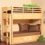 natural tone low profile bunk bed design with green and brown combination and wooden floor and gray area rug
