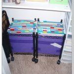 new style of scrapbook paper organizer idea with purple color and black pole stand on desk