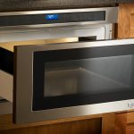 nice-look-silver-jenn-air-miccrowave-drawer-ovevn-JMD2124WS-with-power-level-and-sensor-cooking-and installed-in-brown-wooden-cabinet-also-under-counter (1)