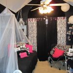 old hollywood glamour decor in bedroom decorating ideas with pink and black theme plus mid century fan with lighting and lantern lamp plus folding chairs and cozy bed