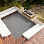 outdoor hot tub idea with white bench for seating with wooden deck patio with small garden