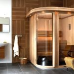 perfect bathroom with sauna design with curved style and cream chair and gray tile flooring and white wall accent