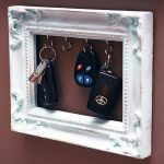 picture-frame-key-rack-for-DIY-key-rack-with-white-frame-and-hooks-and-keys-on-the-red-wall