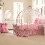 pink-carriege-canopy-bed-for-girls-near-pink-sofa-surrounded-with-white-wall-and-windows-with-white-curtain-also-mirror-on-the-white-dresser-and-beige-floor