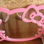 pink-hellokitty-wall-mirror-with-flower-pattern-brown-and-brown-wooden-floor