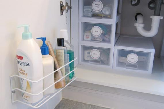 pretty neat underneath bathroom sink organizer with wire wall rack and clear plastic storage boxes to see what inside with labels from houselogic com 24455