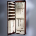 rectangular hanging jewelry airmore made of wooden featuring hooks for necklace and earring plus storage for bracelets