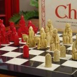 Red And White Pieces With Chessboard Known As The Isle Of Lewis Chess Set As Featured In The Harry Potter Movie(1)