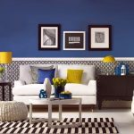 retro interior design with blue and honeycomb wallpaper idea with white sofa and blue and yellow cushions and yellow table lamps and stripe rug