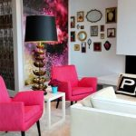 retro interior with glorious wallpaper odea and frame target and pink armchairs and white sofa and white flooring
