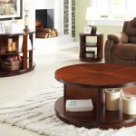 round coffee tables with storage made of wood combined with brown sofa and side table plus furry rug and fireplace