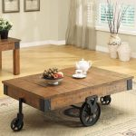 rustic-coffee-tables-with-wheels-fruits-centerpiece-and-white-cup-set-and-carpet-on-wooden-floor-and-soft-grey-wall-and-flowers-in-small-black-pot