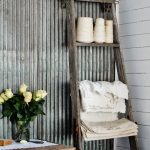 rustic-ladder-shelf-from-repurposing-ladder-shelf-for-toiletries-in-the-bathroom-near-rustic-table-with-yellow-flowers-centerpiece