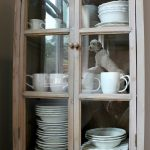 rusticstorage cabinet with glass doors for decorative plates and mug