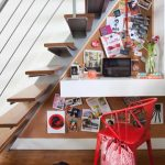 shabby chic understairs home office design with floating wooden steps and wire railing with white floating desk and red chair and wooden floor