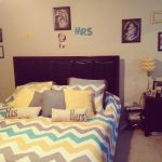 simple bedroom decor idea with chevron gray and yellow sheet and pillows and wall picture