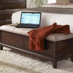 simple bedroom ideas with end of bed storage bench made of walnut in dark finishing plus soft fur rug area