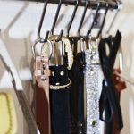 simple belt storage ideas arranged on metal hooks
