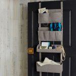 simple cloth over the door basket storage design in gray tone with sack model over black wooden door