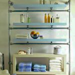 Simple Metal Towel Shelf With Blue Accent In Bathroom With White Painted Wall