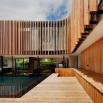 spacious contemporary wooden house design with two storey and wooden deck and pool and wooden siding