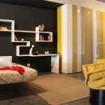 spacious urban bedroom decor with yellow and gray colr combination and large closet and unique wall shelves and yellow sofa