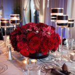 strong-and-pretty-also-short-and-low-centerpieces-with-red-flowers-black-containers-and-tall-candleholders-on-red-balck-and-white-wedding-reception-theme