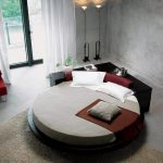 stunning cheap round bed ideawith black headboard and red bed sheet and red sofa and chandelier and open plan