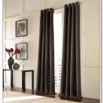 stunning interior design with black silky curtain design on long stainless steel tension rod aside black console table and red tulips and wall palette