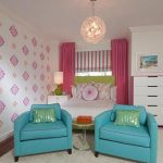 stunning living room with pink curtain and turquoise sofa and chandelier and white dresser and patterned peel and stick paper
