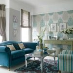 stunning turquoise sofa idea with vintage coffee table and patterned gray blue rug and wallpaper and glass window