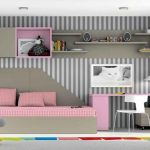 stunning vertical stripe peel and stick paper design in bedroo with pink sofa and desk and wall rack and colorful area rug