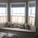 stunning window treatment and curtain rods for bay windows with half window curtain and shades plus comfy bench with decorative cushions