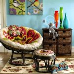 stylish-and-modern-papasan-chair-with-ottoman-and-white-flower-carpet-on-the-ceramic-floor-and-colorful-vases-and-blue-color-wall