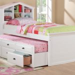 Super Lovely White Pin Pop Up Trundl Bed Frame Idea With Storage Headboard And Colorful Area Rug And Wooden Floor And Green Chair And Glass Window