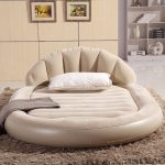 sweet creamy cheap round bed design with upholstered headboard and edging and cream furry area rug and wall  palette