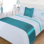 teal bedcover for white bed linen teal throw pillow white pillows with teal dots as decoration a white classic console as the bedside table
